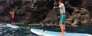 Practica el Stand Up Paddle bajo los acantilados volcánicos de Martiánez